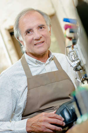 elderly man in apron Stock Photo