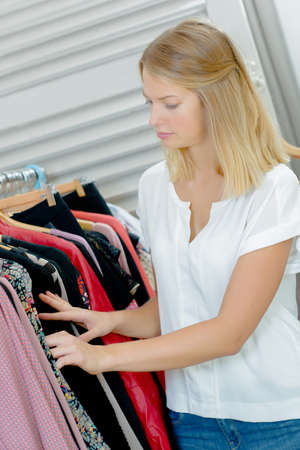 passerby: discounted clothing on display