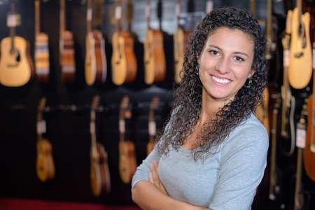 Portrait of woman in guitar shop