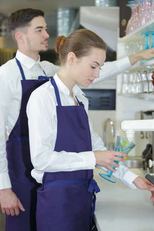 serf: young waitress and waiter