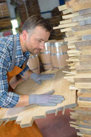 carpenter's bench: Cooper aligning planks of wood