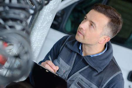 mechanician: young man car mechanician
