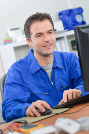 journeyman technician: Electrician at his desk Stock Photo