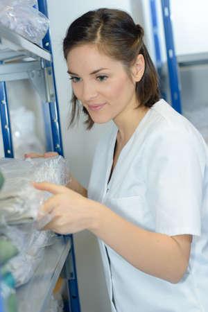 Woman in hospital laundry room Stock Photo