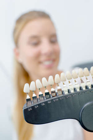 Unfocused lady behind sample teeth