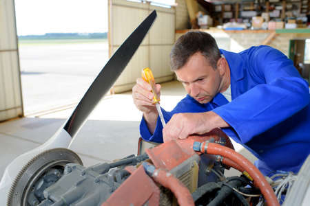 engineering tool: Mechanic working on aircraft