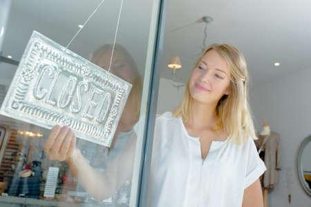 girl closing a shop
