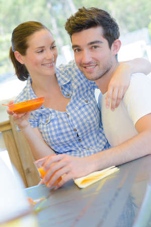 persuades: couple having a nice breakfast