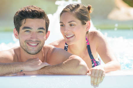 couple inside the pool