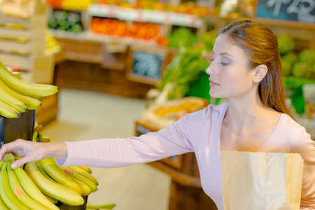 buying: Lady buying bananas