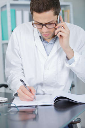 young chemist on the phone in lab Stock Photo
