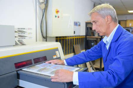 tending: worker tending on a machine Stock Photo