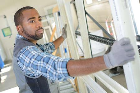 double glazing: Man manufacturing upvc windows Stock Photo