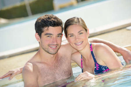 hairy: Portrait of couple in a pool Stock Photo