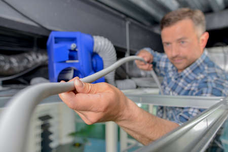 electricity providers: Electrician holding cable