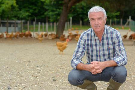 farmer inside a chicken run