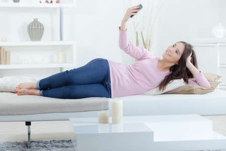 lates: girl doing a selfie Stock Photo