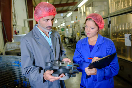 middleman: working in a factory Stock Photo