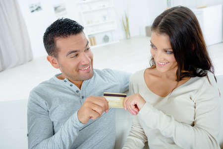 persuades: Couple both holding credit card