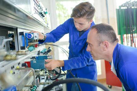 Apprentice electrician under supervision