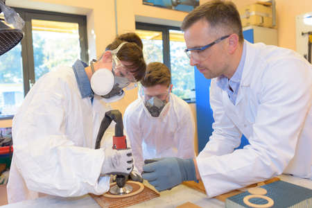 safety googles: scientist teaching students in laboratory