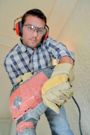 pneumatic: Using a pneumatic drill Stock Photo
