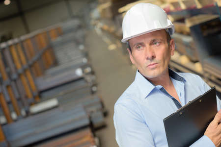 defects: supervisor checking the area Stock Photo