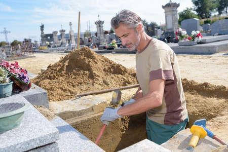 tiring: digging a grave