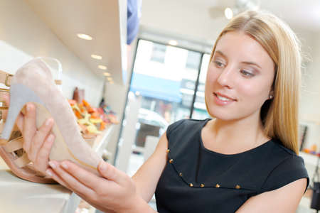 this: Woman trying on some shoes Stock Photo