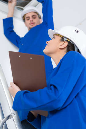 electricians working in buildings ceiling