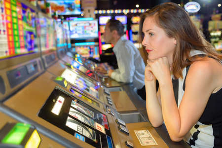 miserable: Miserable woman sat at arcade game