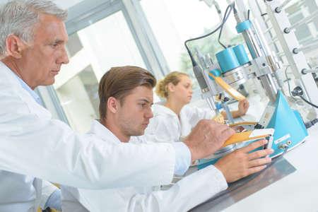 handome: technicians in laboratory Stock Photo