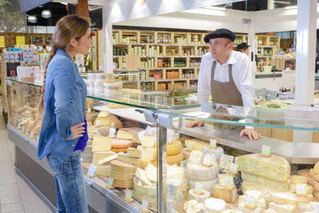 basque woman: Woman at French cheese counter