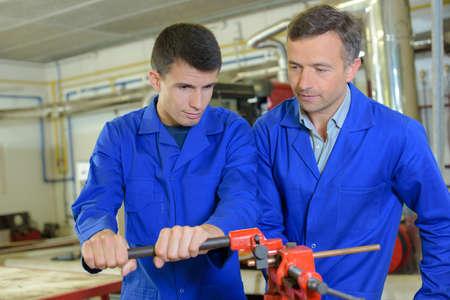 vise: Apprentice using a vise