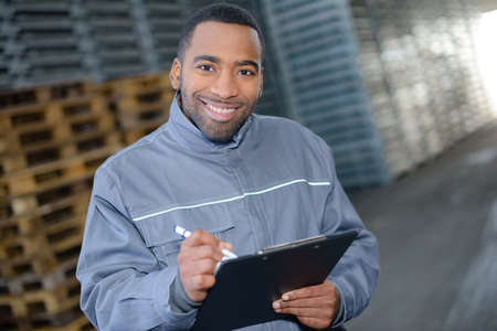 assigned: warehouse worker holding a document Stock Photo