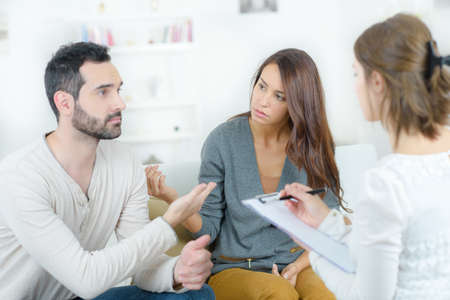 spat: stressed young couple quarrel at the psychologist