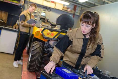 quad: Mechanics with quad on workbench