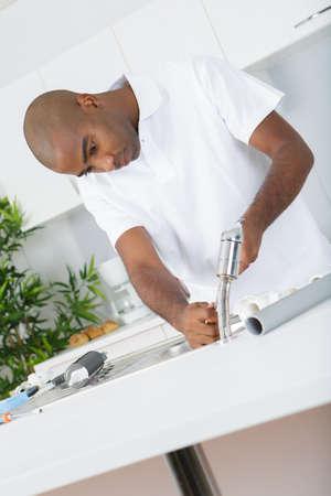 fixing: fixing the tap Stock Photo