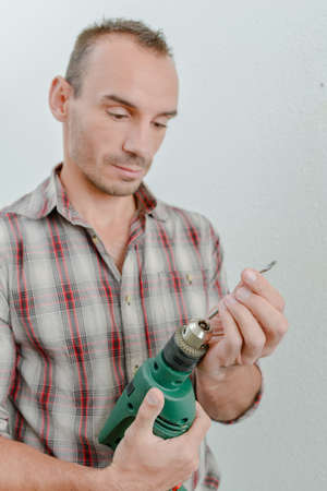 drill bit: Changing a drill bit Stock Photo