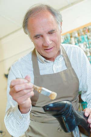 sole: Shoe-repairer repairing a sole