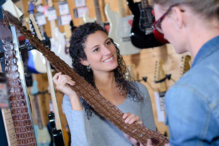 serf: in a music shop Stock Photo