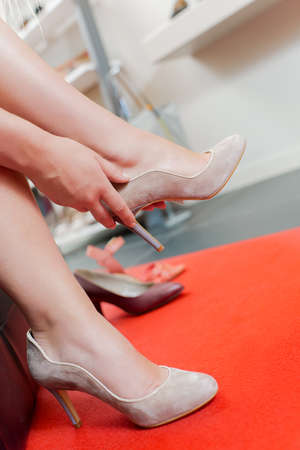 the latest models: woman trying on stiletto