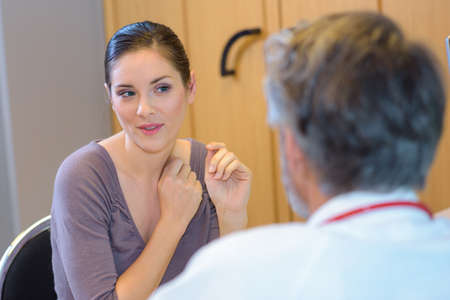 doctor appointment: Female patient questioning doctor Stock Photo