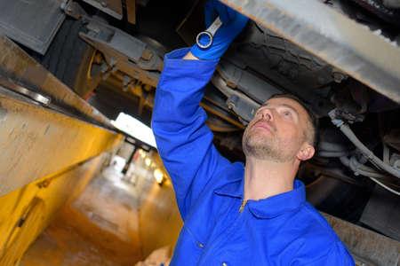 mechanician: Mechanic working in pit Stock Photo