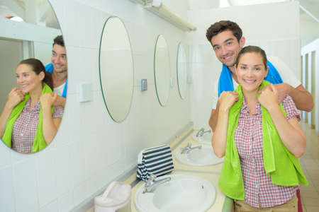 communal: Portrait of couple in communal washroom Stock Photo