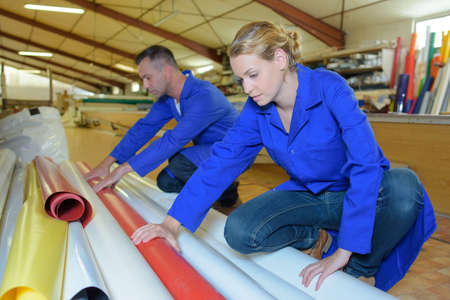 pliable: Man and woman choosing roll of material