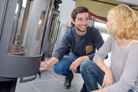 woodburner: Couple looking at display of woodburners