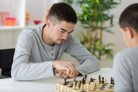two students playing chess Stock Photo