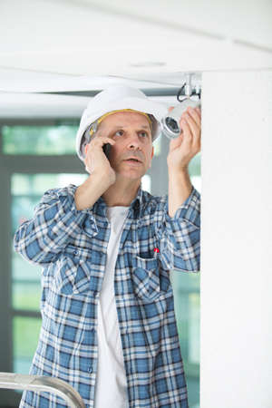 journeyman technician: electrical engineer make phone call to control center