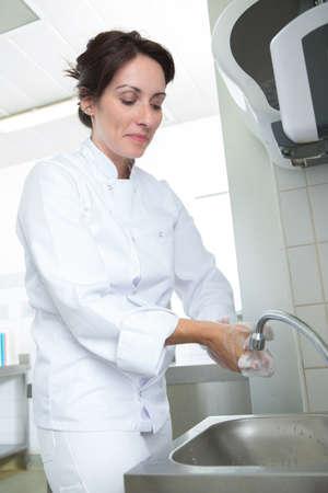 woman handwashing sinks
